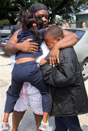 Image: Evette Davis hugs her daughter Heaven, 5, and son Julian, 9