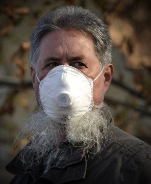Image: Hungarian resident wears mask to protect from toxic red sludge