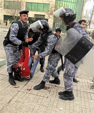 Image: Iraqi riot police officers