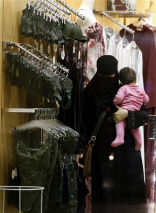Image: A Saudi woman looks at lingerie
