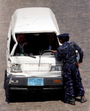 Image: Yemeni police stop a car at a checkpoint Thursday.