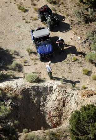 Image: Police investigate an abandoned mine shaft