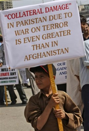 Image: A Pakistani boy holds up a placard