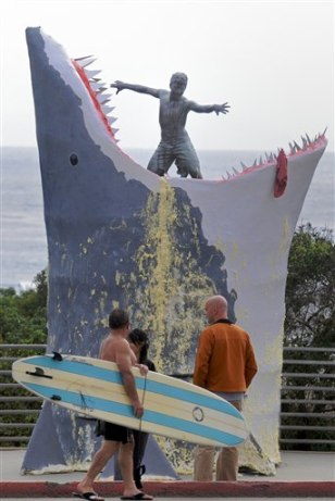 Image: Surfers look at sculpture in Cardiff-by-the-Sea, Calif.