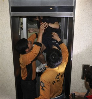 Image: Man freed from stuck elevator