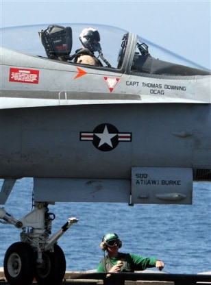 IMAGE: JET ON AIRCRAFT CARRIER