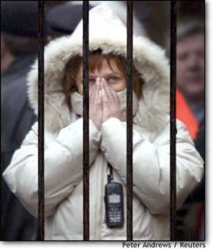 Image: A Woman Covers Her Face As She Waits For Information About Relatives In Moscow