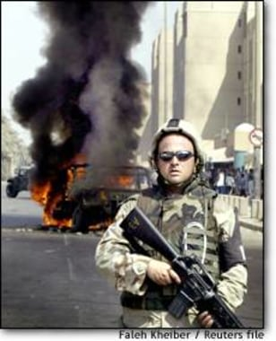 Image: A U.s Army Military Policeman Secures The Area After A Humvee Was Hit By A Rocked-propelled Grenade In Baghdad