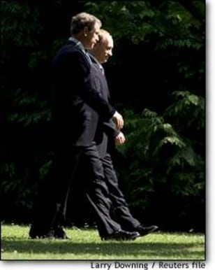 Image: Russian President Putin Walks With Us Counterpart George W Bush In Slovenia
