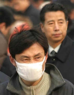 Image: Chinese man wearing a mask