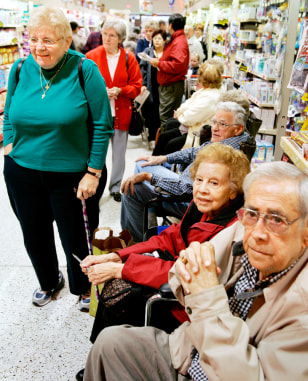Elderly and high risk patients wait in line to receive flu vaccine in Northern Virginia