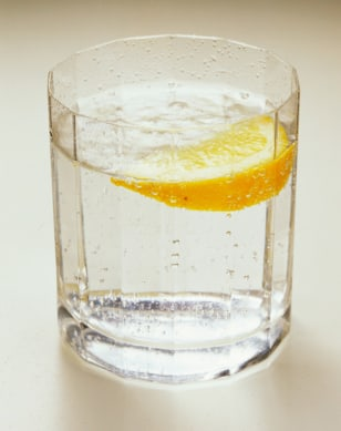 Image: glass of water with lemon wedge