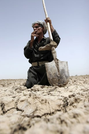 Image: Man in dry field
