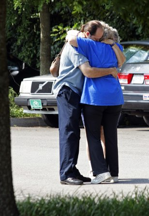 Image: Members of the Tennessee Valley Unitarian Universalist Church hug on Monday