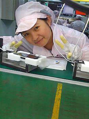Image: Chinese technician poses at an iPhone assembly plant