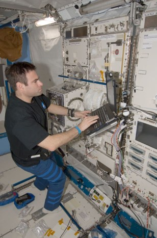Image: Chamitoff and computer on space station