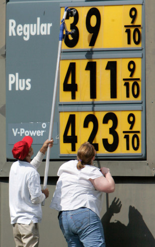 Image: Little Rock, Ark., gas station employees change the price sign for fuel Friday, Sept. 12, 2008.