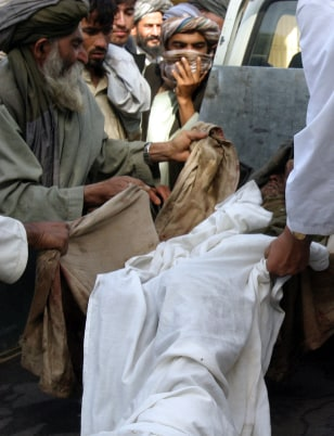 Image: Body of a Taliban militant loaded onto vehicle