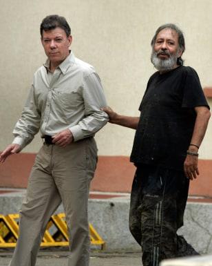 Image: Juan Manuel Santos, left; Oscar Tulio Lizcano