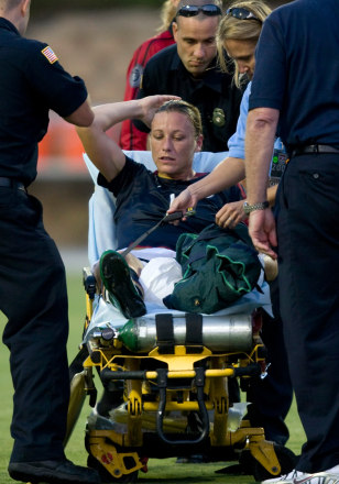 Image: Wambach of the U.S. is strapped onto a stretcher by paramedics during their international friendly soccer match in San Diego