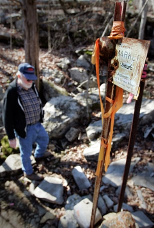 Image: Georgia resident Jerry Body walks past a marker in Cole City Hollow Tenn.