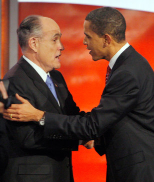 Image: U.S. Presidential candidates Giuliani and Obama talk on stage between debates in Manchester