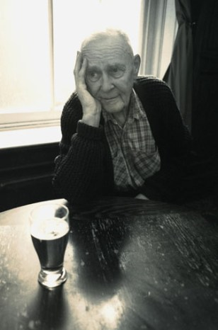 Image: Elderly man with a beer