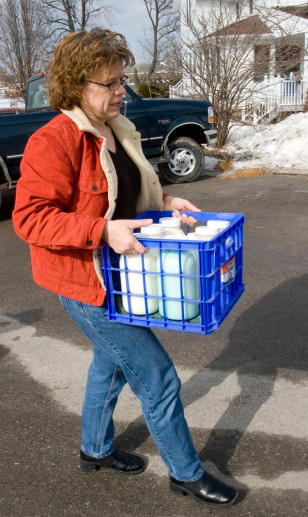 Image: Jane Ratajczak carries her raw milk.