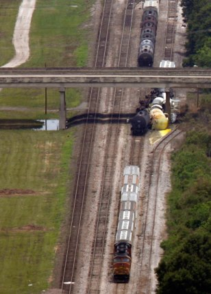 Image: Train cars are derailed in Lafayette, La.