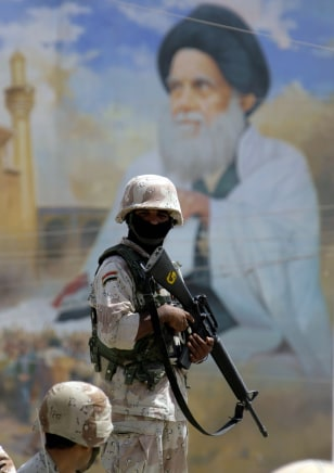 Image: An Iraqi soldier stands guard