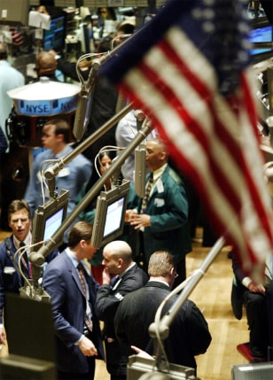 TRADERS WORK ON FLOOR OF NEW YORK STOCK EXCHANGE ON FINAL TRADING DAY BEFORE CHRISTMAS