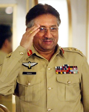 PAKISTAN PRESIDENT GENERAL PERVEZ MUSHARRAF SALUTES AT A SEMINAR IN ISLAMABAD