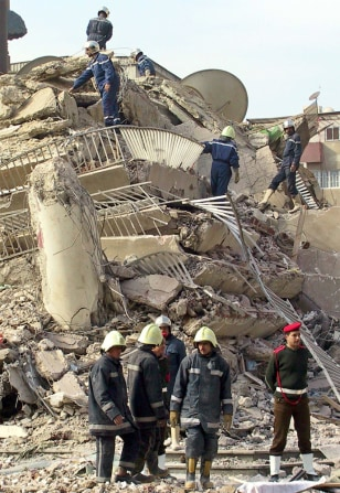 RESCUE WORKERS LOOK FOR SURVIVORS UNDER THE RUBBLE OF A COLLAPSED BUILDING IN CAIRO