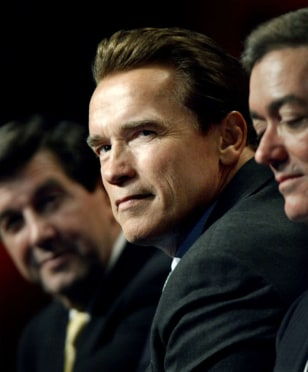 SCHWARZENEGGER LOOKS TOWARD PRESIDENT BUSH AS HE SPEAKS TO GOVERNORS