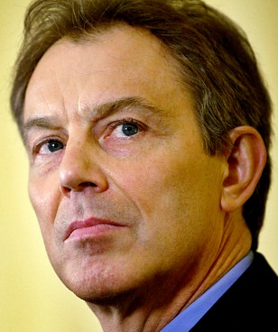 BRITAIN'S PRIME MINISTER BLAIR LISTENS AT A NEWS CONFERENCE IN DOWNING STREET LONDON