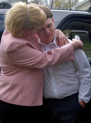 CRIME VICTIM PATRICK HOLLAND RECEIVES A HUG FROM FOSTER AUNT