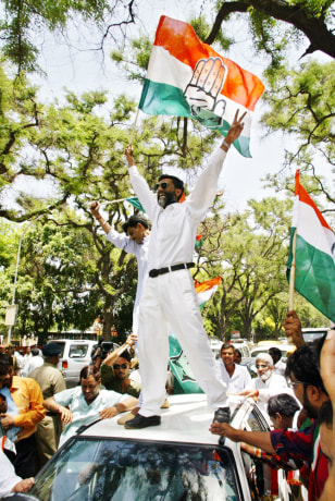 Image: Supporters of India's Congress party celebrate.