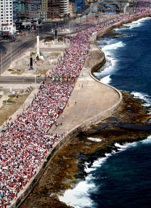 AERIAL VIEW OF CUBANS MARCHING ALONG HAVANA'S SEAFRONT