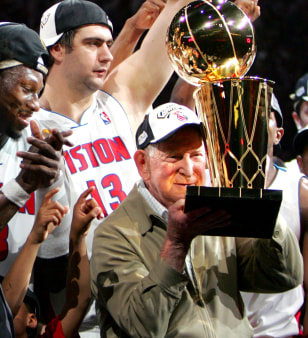 PISTONS OWNER WILLIAM DAVIDSON CELEBRATES WITH LARRY OBRIEN TROPHY