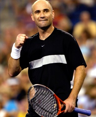 AGASSI CELEBRATES HIS QUARTER-FINAL VICTORY AT INDIAN WELLS