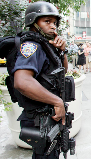 Heavily armed policeman outside Citigroup building in New York