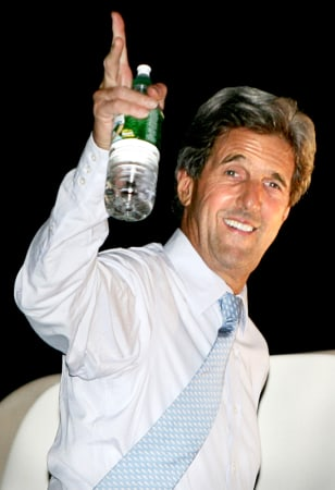 U.S. Democratic presidential nominee Kerry waves from plane