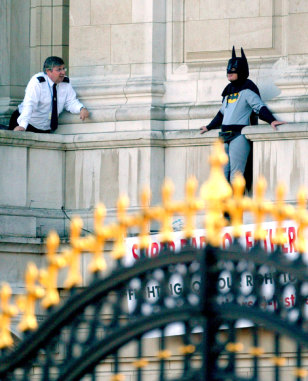IMAGE: BATMAN PROTESTER AT BUCKINGHAM PALACE