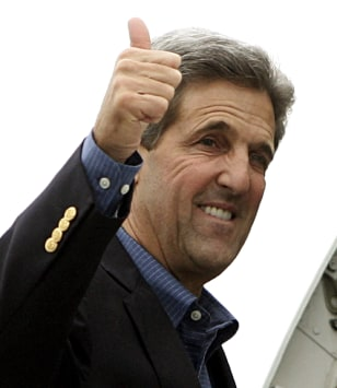Image: Kerry boards plane