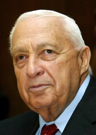 Israeli Prime Minister Ariel Sharon attends a meeting with Israeli President Moshe Kazav in Jerusalem