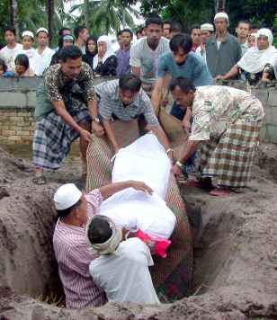 Relatives bury a Muslim demonstrator at a cemetery in Narathiwat province