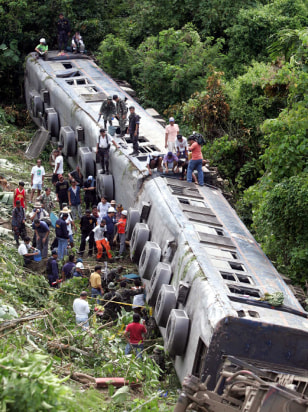 IMAGE: Rescuers search Philippine train crash