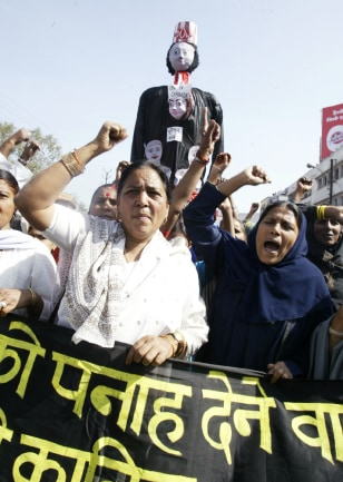 Victims of the 1984 Bhopal gas tragedy shout slogans in Bhopal