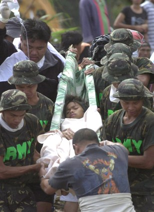 Image: Philippine survivor carried on stretcher.