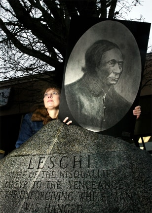 Image: Descendent of Nisqually Indian Chief Leschi holds his portrait.